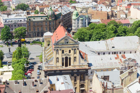 Ensemble of the Jesuit Church of Sts. Peter and Paul built in the 17-th century, view from tower of city town hall in Lviv, Ukraine Stock fotó