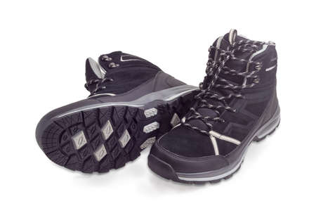 Pair of the black trekking boots on a white background Stock Photo