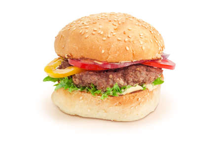 Hamburger with beef patty, vegetables and condiments on a white background
