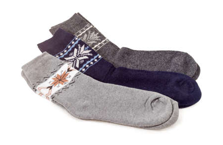 Three pairs of the different wool thermal socks on a white background