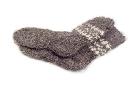 Pair of the thick gray wool hand-knitted socks on a white background  Stock Photo