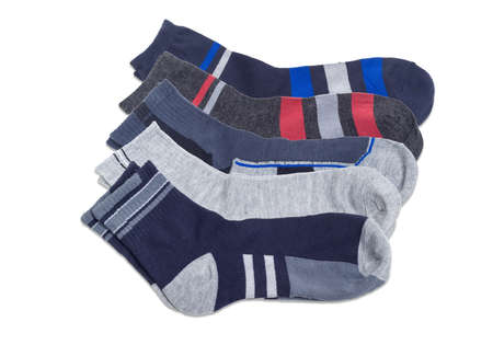 Several pairs of the different varicolored mens socks on a white background