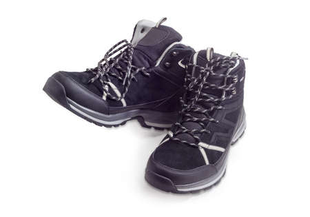 Pair of the black trekking boots on a white background