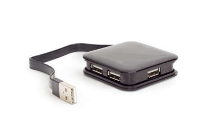External separate USB hub in black square plastic casing with short cable on a white background