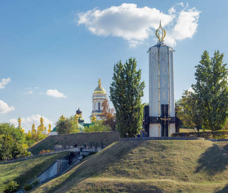 Kiev, Ukraine, October 08, 2015: Memorial complex of the National Museum Memorial to Holodomor victims on background of the Kiev Pechersk Lavra Editorial