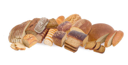 Whole and partly sliced loaves of the different types of brown bread, multi grain bread with various seeds and bread with bran on a white background
