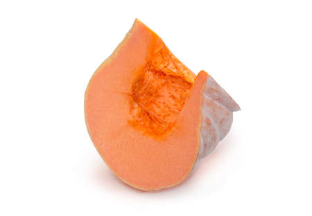 Piece of the orange pumpkin on a white background