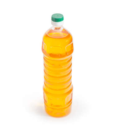Plastic bottle of the edible corn oil on a white background