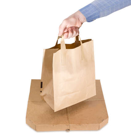 Packaging for meals delivery - paper bag in man hand and pizza box tied with twine on a white background