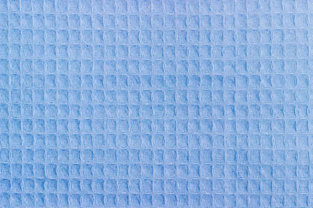 Background of the blue waffle towel with horizontal layout of pattern closeup