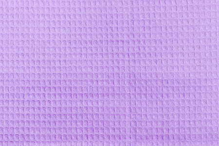 Background of a surface of the purple waffle towel with horizontal layout of pattern
