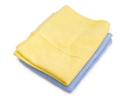 Stack of two blue and yellow folded waffle towels on a white background