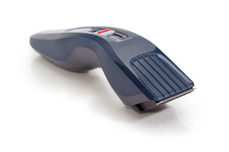 Electric hair clipper with hair cutting height adjustment at selective focus on a white background