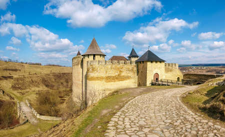 Khotyn fortress built in the 14th century. General view of fortress from the south, road to the main entrance at early springtime, Ukraine