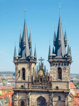 Top part of west facade of the Church of Our Lady before Tyn with gothic towers and spires closeup in Prague. View from the Old Town City Hall