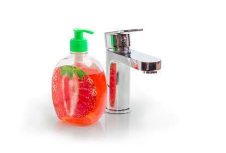 Handle mixer tap and liquid soap with strawberry flavor in plastic bottle with pump and dispenser on a white background