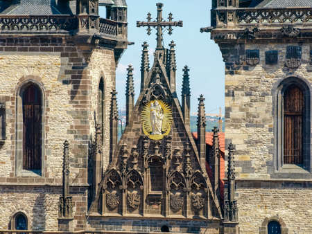 Fragment of west facade of the Church of Our Lady before Tyn with a gilded statue of the Virgin Mary in a halo closeup, Prague  Stock Photo