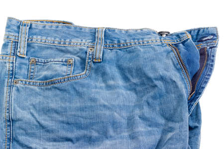 Fragment of the top of the used crumpled blue jeans on a white background  Stock Photo