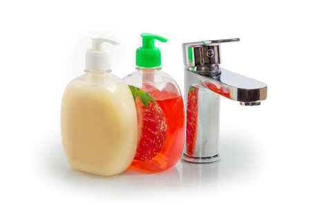 Handle mixer tap and two different liquid soap in plastic bottles with pump and dispenser on a white background