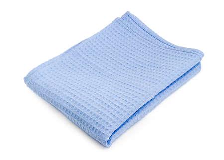 Folded blue waffle towel on a white background