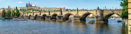 Panorama of the Charles Bridge over the river Vltava on background of the Lesser Town and Prague Castle in springtime, Prague   Stock Photo