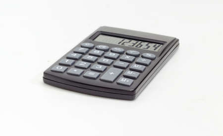 Modern electronic pocket calculator with a liquid-crystal display at selective focuson on a white background  Stock Photo