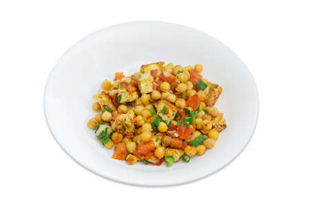 Cooked chickpea with pieces of chicken and vegetables on the white dish on a white background  写真素材