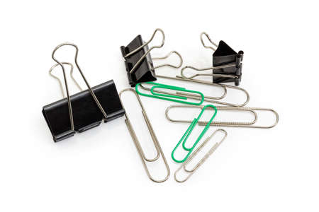 Several different black binder clips different sizes and wire paper clips different colors and sizes closeup on a white background