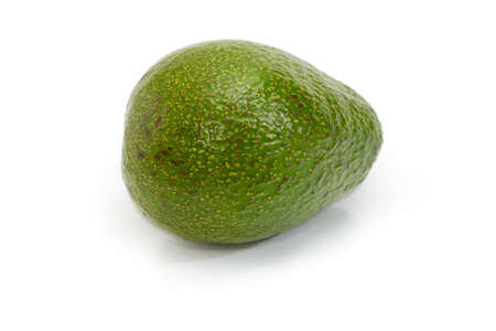Whole green-skinned pear-shaped avocado fruit on a white background Stock Photo