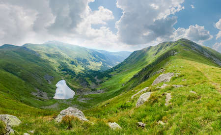 Top view of the mountain ranges and highland valley with Brebeneskul lake located in cirque in the Carpathian Mountains, Ukraine