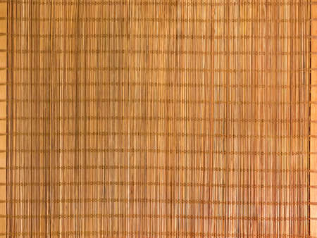 Background of the empty rectangular woven bamboo table mat close-up