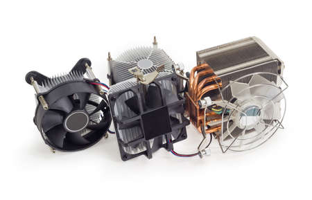 One active CPU cooler with fan and copper thermal pad with heat pipes and several different CPU coolers with aluminum heatsinks and fans oon a white background