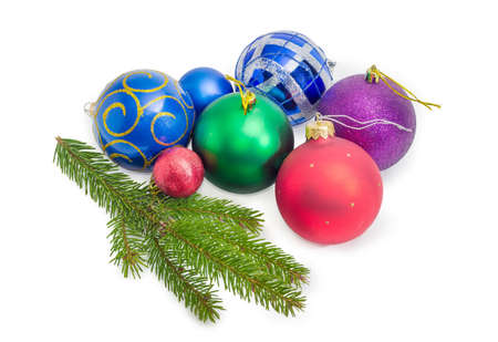 Living branch of spruce and Christmas balls different sizes and colors on a white background