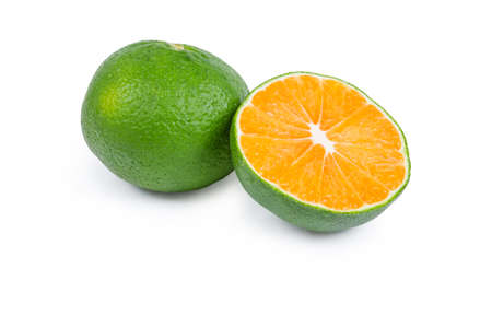 Half and whole  ripe green tangerine on a white background