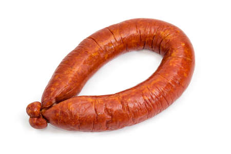 Pork bologna sausage in natural casing curtailed by a ring on a white background Stock Photo
