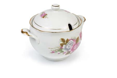 Vintage ceramic white painted tureen with lid on a white background Фото со стока