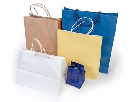 Paper shopping flat-bottomed bags without plastic different sizes and colors with handles and on a white background