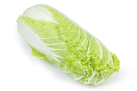 Whole head of napa cabbage also known as chinese cabbage, close-up at selective focus on a white background