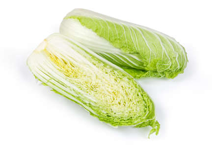 Two halves of head napa cabbage also known as chinese cabbage, cut along on a white background 스톡 콘텐츠