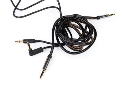 Two different analog audio cables with gold-plated stereo connectors mini jack on a white background