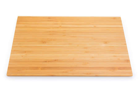 Rectangular kitchen cutting board made from the bamboo multiple pieces on a white background