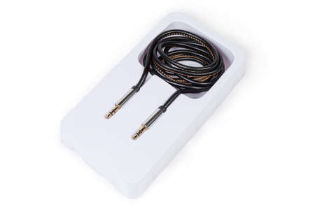 High-fidelity analog shielded audio cable with gold-plated stereo connectors mini jack in plastic packaging on a white background