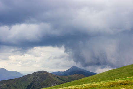 Thundercloud over mountain ridge. Chornohora range, mount Hoverla, Carpathian Mountains