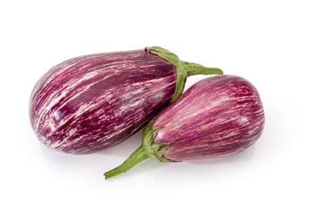Two ripe mottled striped purple eggplants, so-called graffiti eggplant on a white background