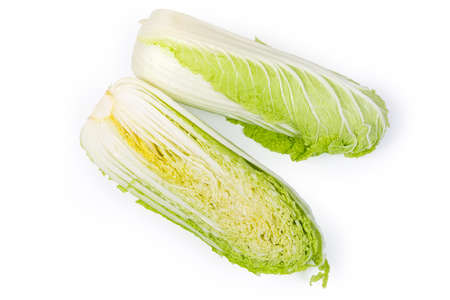 Two halves of head of the fresh napa cabbage also known as chinese cabbage, cut along on a white background, top view 스톡 콘텐츠