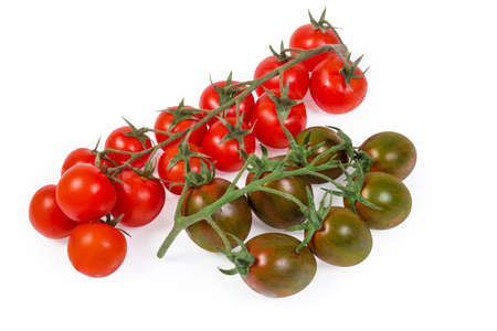 Clusters of the fresh ripe red cherry tomatoes and green with reddish brown cherry tomatoes kumato on a white background