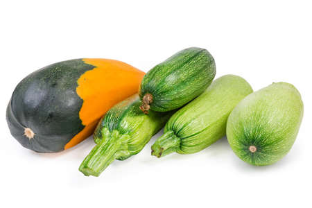 Different fresh raw vegetable marrows and zucchini on a white background