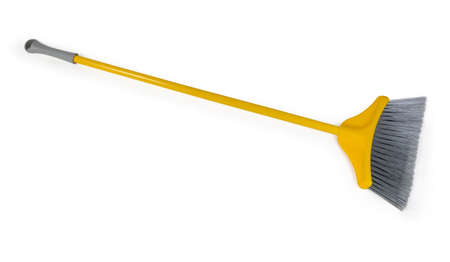 Yellow plastic broom with gray bristles for sweeping floors on a white background Imagens