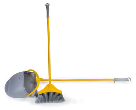 Kit of the yellow plastic broom with gray bristles for sweeping floors and long-handled dustpan on a white background