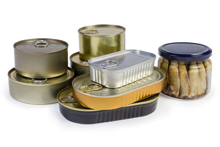 Canned fish and seafoods in glass jar and various types of sealed tin cans on a white background